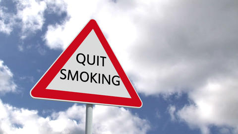 Quit smoking sign against blue sky Animation