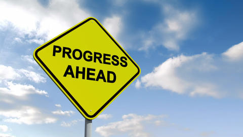 Progress ahead sign against blue sky Animation