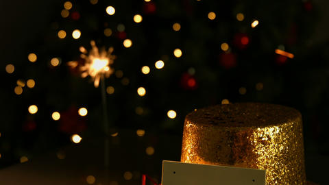 Sparkler Beside A Golden Hat And Card stock footage