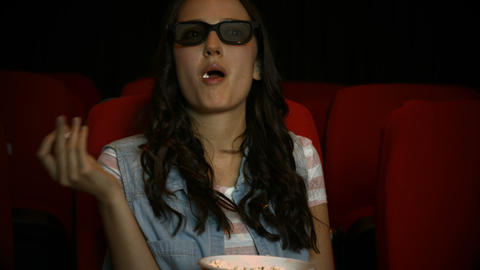 Brunette Watching 3d Movie In Cinema stock footage