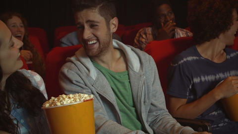 Friends Watching Funny Movie In Cinema stock footage