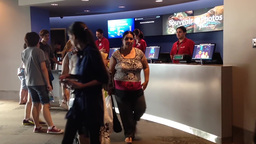 People buying ticket inside Vancouver aquarium Live Action