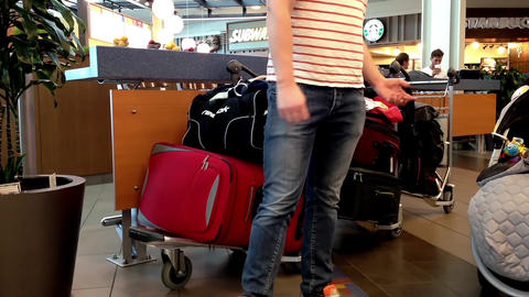Passengers with luggage at food court inside YVR a Footage