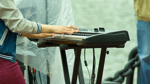 Musician plays a synthesizer, shooting side of the Footage