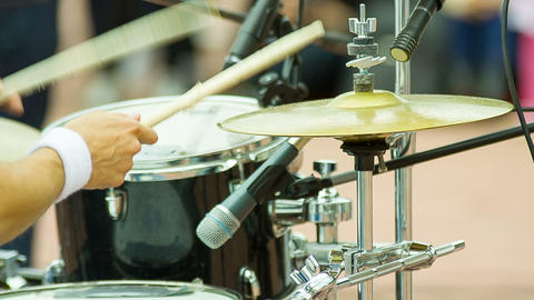 Men's hand beats the drum and cymbal on the street Live Action
