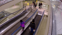 Escalators with shopper coming to superstore at Me Footage