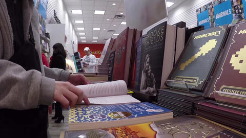 Closeup woman hand going to flip page of book in b Footage
