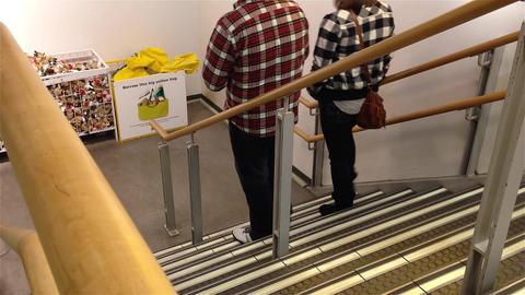 People walking to downstairs inside Ikea store Footage