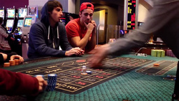 People Playing Roulette Inside Hard Rock Casino In stock footage