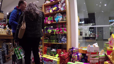 People choosing gift inside body shop store with w Footage