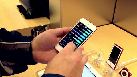 People playing new iphone inside Apple store with  Footage