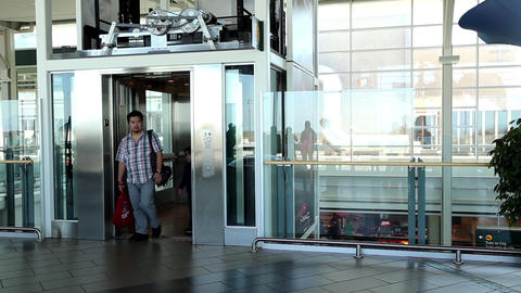 Motion of people taking elevlator inside YVR airpo Live Action