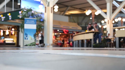 Low angle with people foot walking inside YVR airp Footage