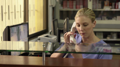 Young Woman Working As Secretary In Hospital Recep stock footage