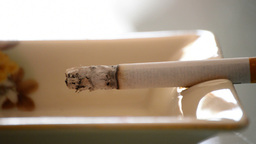 Burning Cigarette In Ashtray stock footage