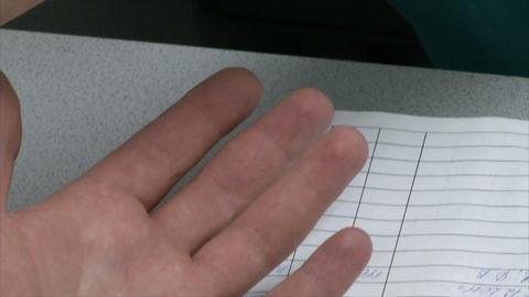 Medical test-taking blood from a finger, gloved ha Live Action