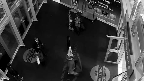 Top shot of mall entrance of people walking throug Footage