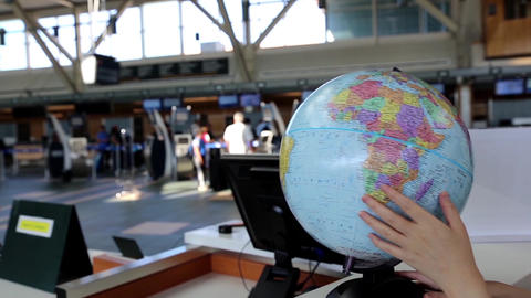 Woman Checking Globe Map At Information Desk Insid stock footage