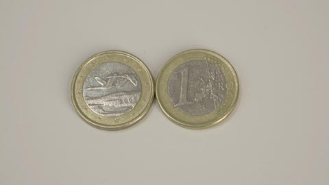 Two 1 Finnish Euro coins on the table Footage