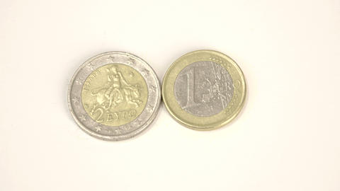Two Greece Euro coins 2 Euro and 1 Euro on the tab Live Action