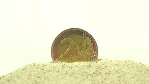 2 Euro coin standing on the white pebbles Footage