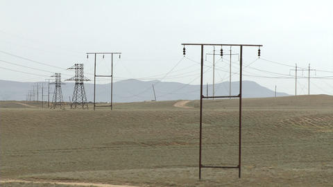 Power Lines In The Caucasus Mountains - Summer Day stock footage