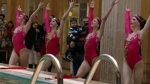 Synchronized swimming in the pool (the lady in red Footage