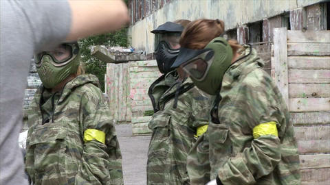 Paintball is when players in green camouflage and  Footage