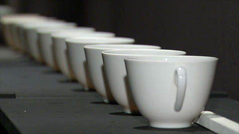 White cup in a row with a change of focus Live Action