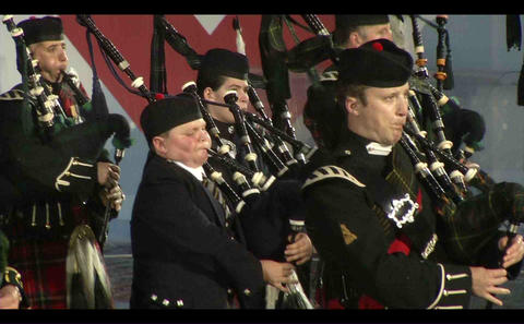 Scottish military musical orchestra in skirts, per Footage