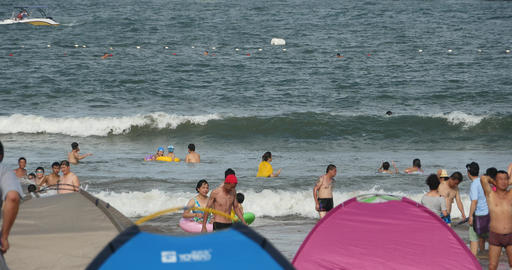 4k many people at crowded sandy beach,People swimming in sea Footage