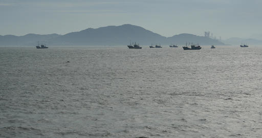 4k Boats Floating In The Sea Against Island Background,distant Shipyard Crane stock footage