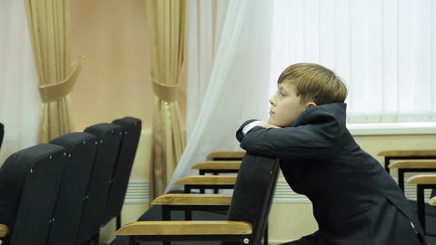 Boy Pupil Sits Pensively On The Couch stock footage