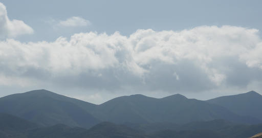 4K Turbulent mountain Cloud,white puffy cloud mass rolling over mountaintop Live Action