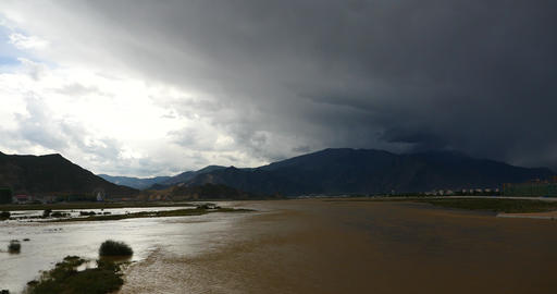 4k Lhasa River,far Away Dark Clouds Mass Rolling Over Tibet Mountaintop stock footage