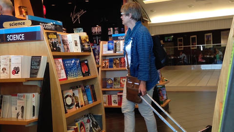 People browsing at bookstore inside YVR airport Footage