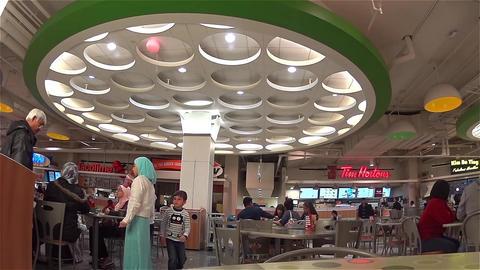 People enjoying dinner in modern mall food court c Footage
