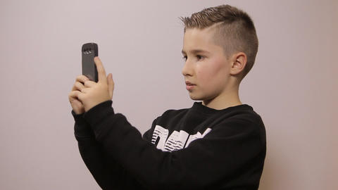 Boy With Phone stock footage