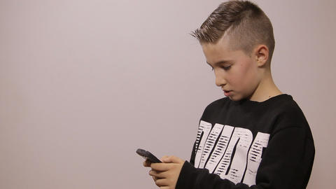 Boy with phone Footage