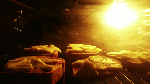 4 K Sandwiches with Cheese in Oven 2 Footage