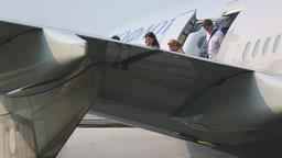 Passengers leave the plane Footage