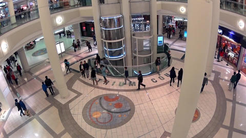 One side of shopping mall with elevator going up w Footage