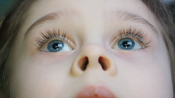 Close Up Of Little Girl Eyes Watching TV stock footage