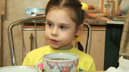 Little Girl Sitting At The Table And Having Di stock footage