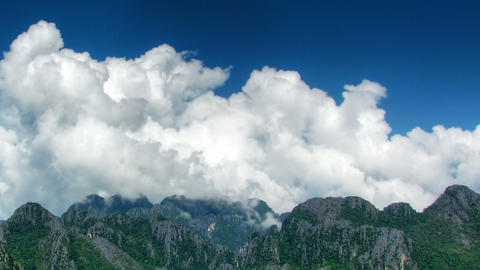 Clouds over mountains time lapse Stock Video Footage