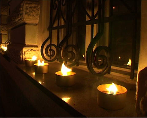 Four candles with a window Stock Video Footage