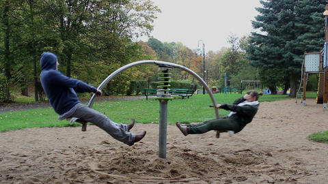 Couple Spin On The Seesaw Springer And The Girl Ge stock footage