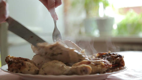 Cut the cooked chicken with a knife Footage
