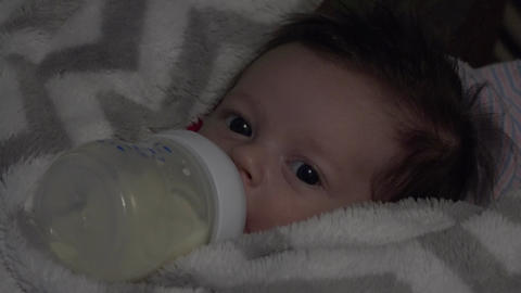 Baby Feeding In Dark stock footage