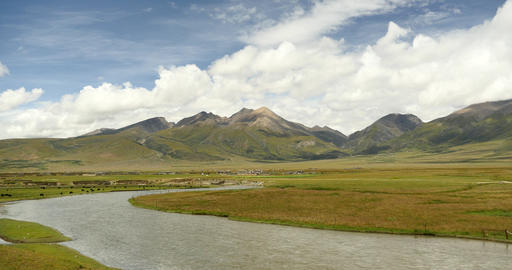 4k clouds mass rolling over Tibet mountain,River flowing through the prairie Footage